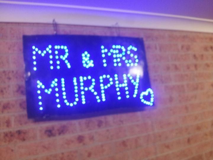 Flashing fairy light sign made out of cardboard box painted black