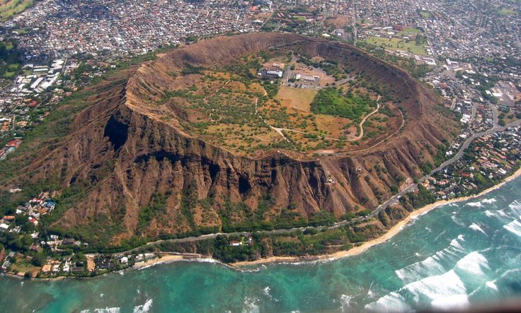 Diamond Head, Hawaii — USA - Diamond Head is the name of a volcanic tuff cone on the Hawaiian island of Oahu. Its name was given by British sailors in the 19th century, who mistook calcite crystals embedded in the rock for diamonds. This crater is a defining feature of the view known to residents and tourists of Waikiki alike.