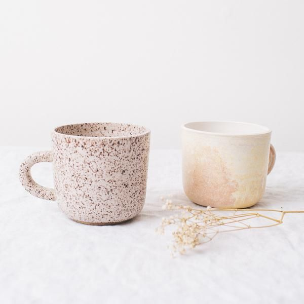 Knit, sip; repeat from first to last drop. Nothing goes with knitting quite like a hot cup of tea or coffee. Wheel-turned and featuring hand-mixed glazes, these mugs and were made for Twig & Horn by ANK Ceramics of Lincolville, Maine. Perfect for those who want their crafting experience to be handmade from start to finish. We also carry matching ceramic pour-overs for drip coffee. Microwave and dishwasher safe. Coquina -  soft peach and yellow, like a southwestern sunset Sparrow - spe...