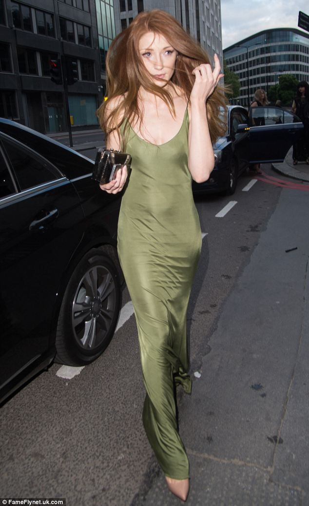 Turning heads: Nicola Roberts stood out at the 2014 Gabrielle's Gala at the Old Billingsgate Market in London, wearing a sumptuous green sil...