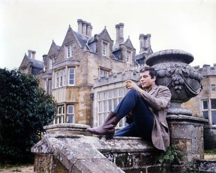 Oliver Reed at his country home Broome Hall.