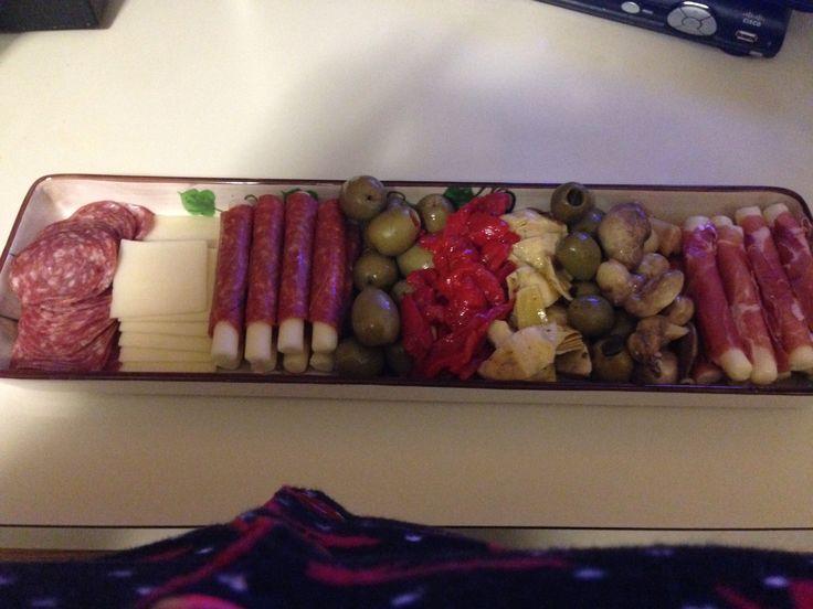 Antipasto platter: sorpressata & provolone, pepperoni Panino wrapped mozzarella, prosciutto wrapped mozzarella, stuffed olives with pimento, marinated mushrooms, and jalapeño stuffed olives
