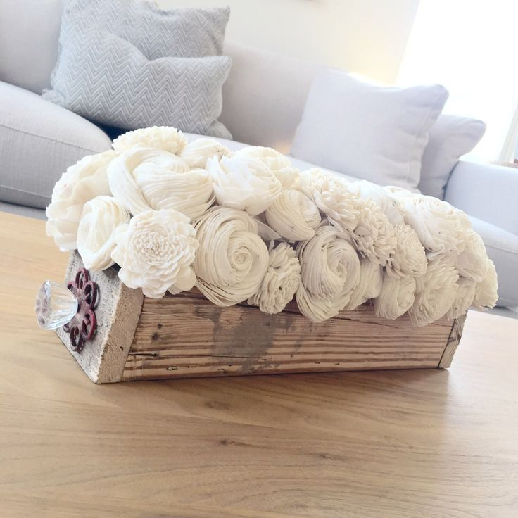 This wood flower centerpiece is made from natural white sola wood flowers, recycled pallet wood, and a recycled door-nob. Let this centerpieces become your one of a kind accent piece at your upcoming wedding, wedding shower, bridal shower, baby shower or even at your next dinner party! Measures 8 inches tall and 18 inches wide.