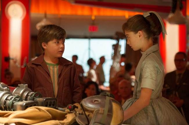 Frank and Athena in a scene in the movie Tomorrowland. Played by Richard Roeper and  Raffey Cassidy. Click to find out everything about the Tomorrowland movie including trailers and review.