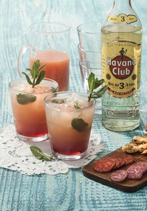 Havana Club Rum 3 years & Grapefruit juice: 1 part Havana, 3 parts grapefruit juice and a drop red syrup. Garnish with a sprig of mint.