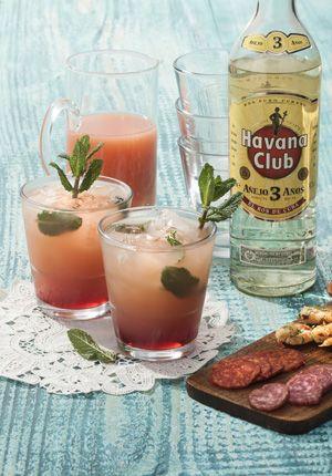 Havana Club Rum 3 years & Grapefruit juice: 1 part Havana, 3 parts grapefruit juice and a drop red syrup. Garnish with a sprig of mint.