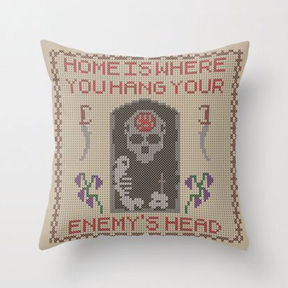 Home is where you hang your enemy's head. Pillow design inspired by the Dark Brotherhood of Skyrim. This can be found for purchase at: http://society6.com/product/home-is-where-you-hang-your-enemys-head_pillow#25=193&18=126