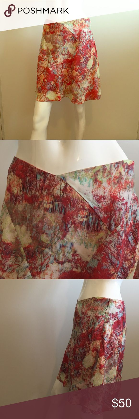 Reiss Flora Print Skirt Retail: $189 BRAND NEW Without Tags super cute..    Reiss Floral Print Skirt    ( Retail Price is $189)    Size: 4    Color: multi     100% lyocell       *** I'm a wardrobe stylist & this skirt was purchased for a film but it was NEVER WORN on set! It's Brand New, as shown in pictures    Waist: 28 inches  Hip: 43 inches  Total Length: 18.5 inches Reiss Skirts Mini