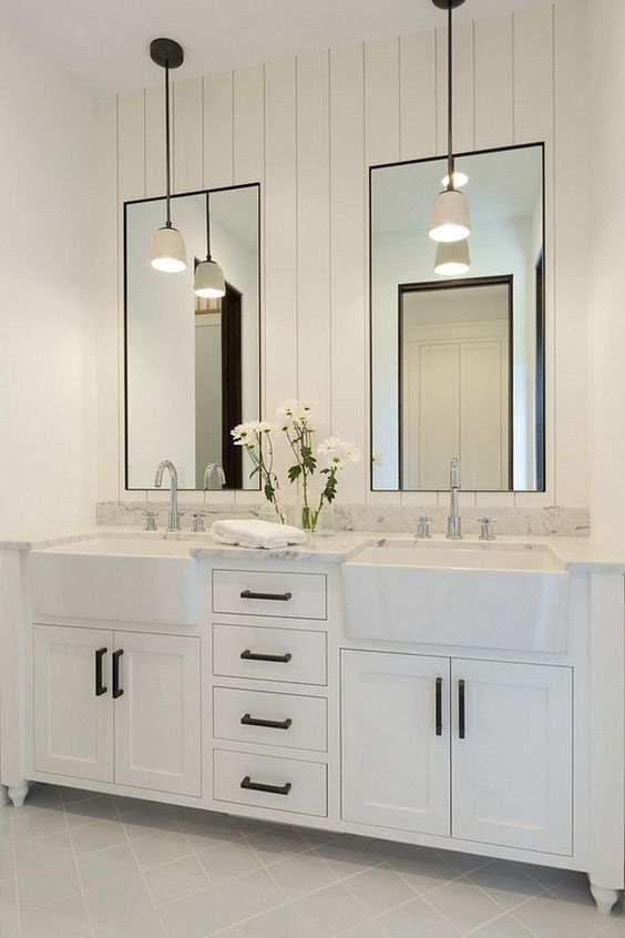 Bathroom shiplap wall behind mirrors. Bathroom with shiplap wall behind mirrors…