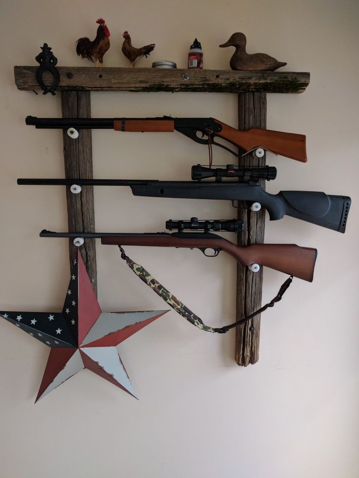 This is a gun rack I made from old fence posts and ceramic electric fence insulators
