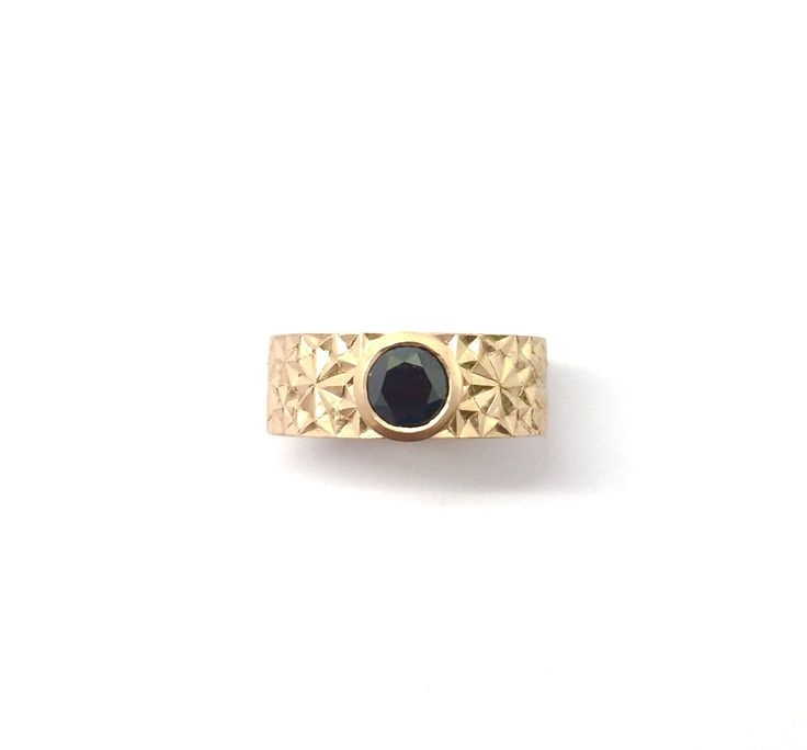 Hand-engraved 18k rose gold ring with a black diamond center stone by Sirkel Jewellery Design