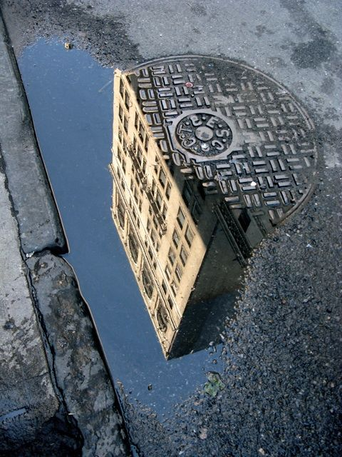 New York City Reflections** is this saying that new york is not clean like a sewer? . . .
