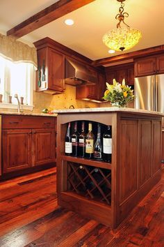 Craftsman Kitchen with Kitchen island, European Cabinets, flush light, Built in wine rack, Stone Tile, L-shaped, Exposed beam