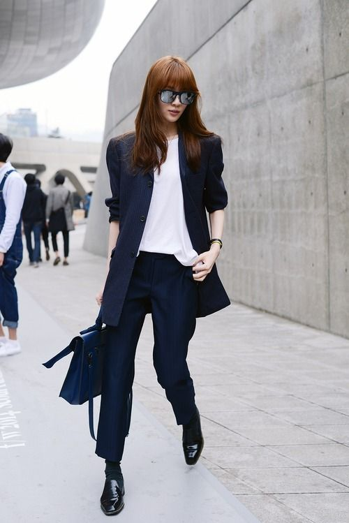 Shop this look for $277:  http://lookastic.com/women/looks/dress-pants-and-loafers-and-satchel-bag-and-socks-and-sleeveless-top-and-blazer/2385  — Navy Vertical Striped Dress Pants  — Black Leather Loafers  — Navy Leather Satchel Bag  — Black Socks  — White Silk Sleeveless Top  — Navy Vertical Striped Blazer
