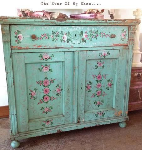 .decoupaged furniture that is shabby chic paint chipped.