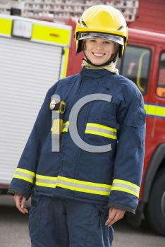 Royalty Free Photo of a Firefighter by a Truck