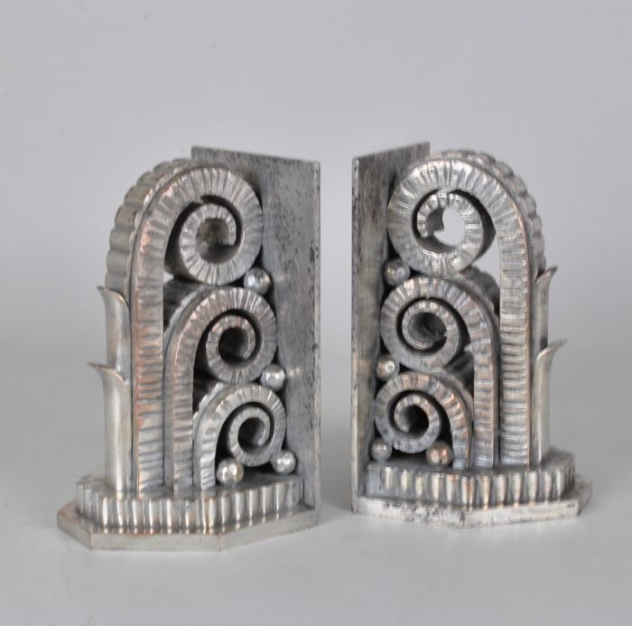 Pair Of Wrought Iron And Chromed Bookends With Triple Volutes On Base With Folded Angles Attributed To Raymond Subes In 2020 Art Deco Interior Bookends Art Deco