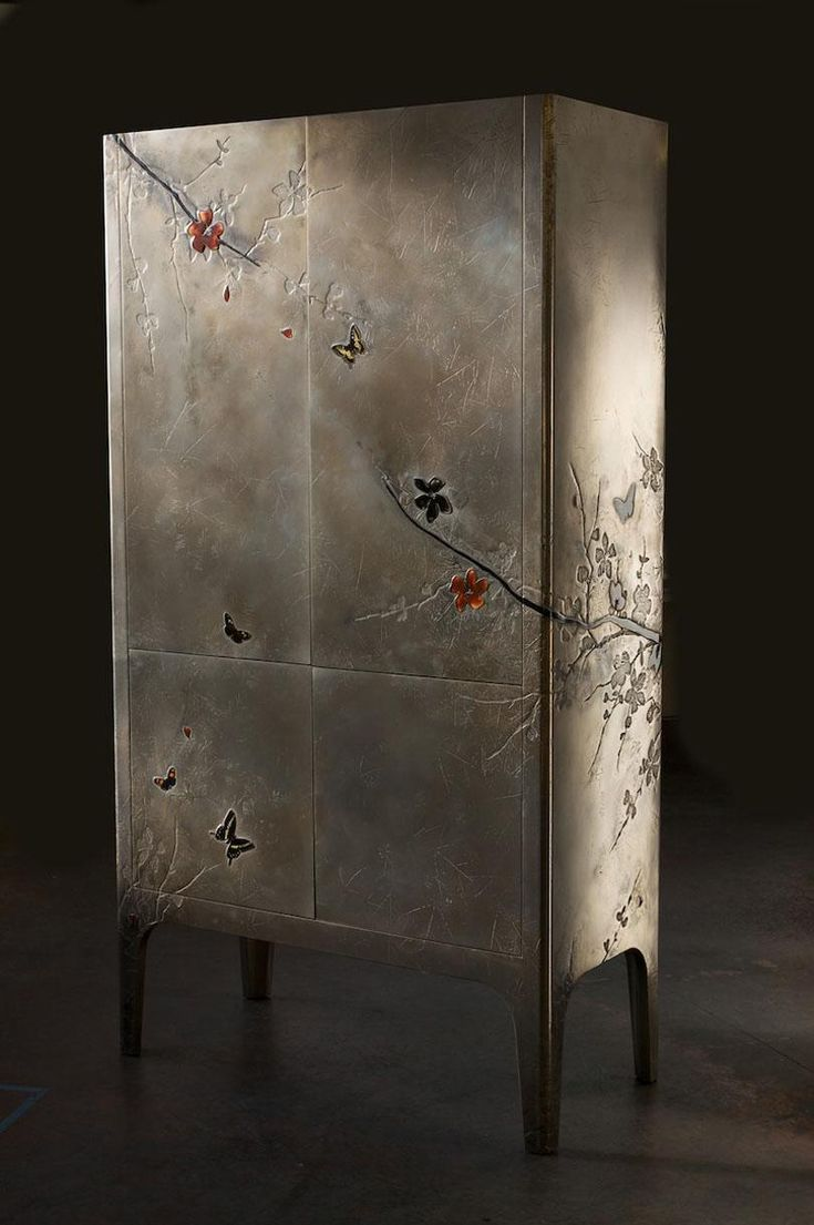 gorgeous detail in the bronze and liquid metal of the case this is the metal chinoiserie credenza from london artists based upon