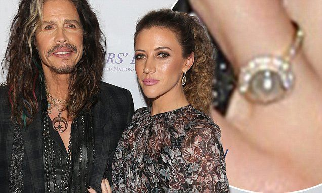 Engaged? Steven Tyler, 68, takes girlfriend Aimee Preston, 28, to UN ball in NYC where she flashes pretty ring on wedding finger...