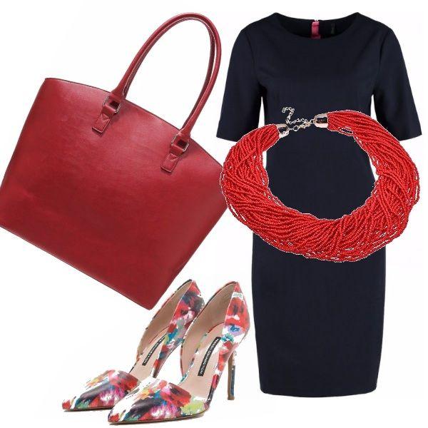 L'abito rigoroso di taglio lineare si accosta al rosso degli accessori ( la borsa capiente e la collana di corallo ) per aggiungere un tocco di allegria, completato dalle scarpe con motivi floreali.