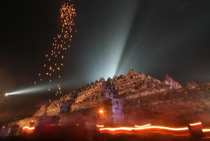 Skylanterns are released near the Borobudur temple during a ceremony to mark Vesak day in Magelang, Central Java