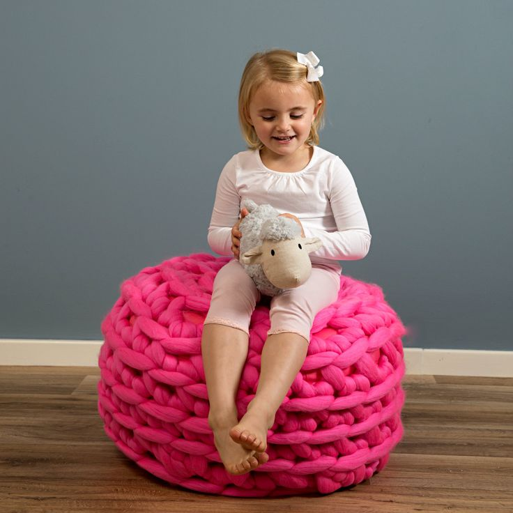 Footstool made with extreme merino yarn  https://www.woolcouturecompany.com/product-category/yarn-rope/  #giant #extreme #yarn #merino #wool #footstool #pink #nursery #childrens #room #roomdecor #arm #crochet #knitting
