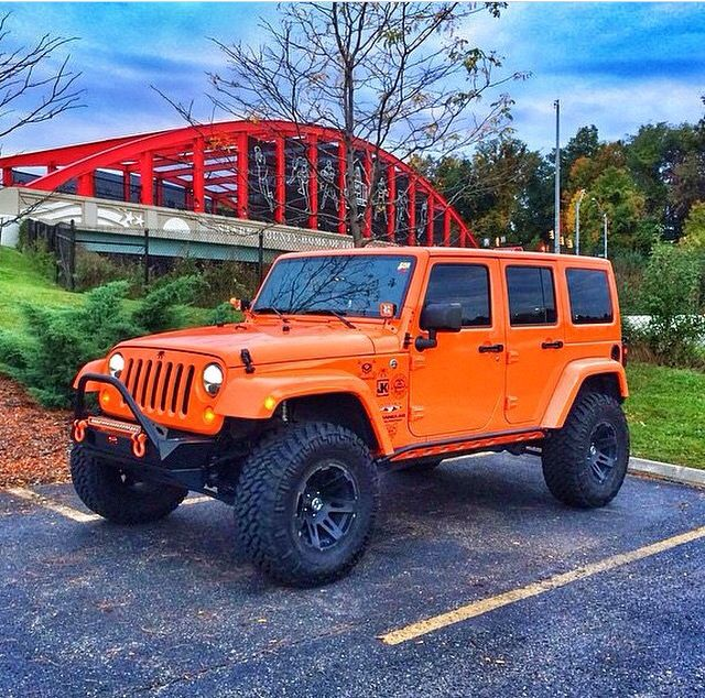 ORANGE 4 DOOR JEEP JK