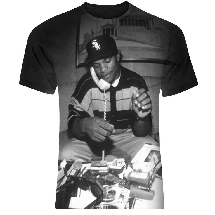 """Easy+-+E+63+/++NWA+Hip+Hop+T+Shirt+-+This+Easy+E+Fan+T+Shirt,+features+an+all+over+print+which+depicts+some+of+what+it+must+have+been+like+to+be+a+rapper+back+in+the+day+when+everything+was+""""coming+straight+outta+compton""""!After+dropping+out+of+high+school+in+the+tenth+grade,+he+invested+in+Ruthless+Records+When+Ruthless+artist+Ice+Cube+wrote+""""Boyz-N-The_Hood"""",+Dre,+Cube,+and+Eazy+formed+N.W.A. The+rear+of+the+t+shirt+also+features+the+text+""""EASY+63"""",+and+just+looks+awesome+when+worn!"""