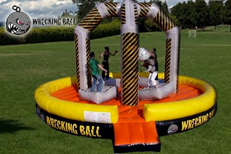 """It's big, it's bold, and it's extreme! It's the Ultimate High Energy game. (4) Players climb atop their inflated pads. One of the players grabs the """"Wrecking Ball"""" and hurls it at their opponent in an attempt to knock the player off of their inflated pad. http://texasentertainmentgroup.com/attractions/sports-inflatables/wrecking-ball/"""