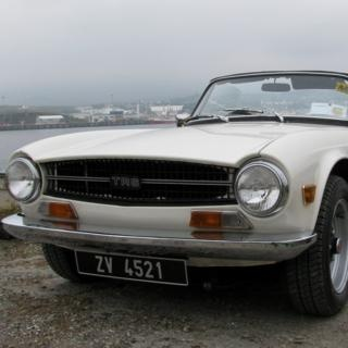 Self-Drive Classics 1 Day Classic Car Hire - Triumph TR6 - Explore the highways and byways of beautiful Donegal in a classic Triumph TR6. The Triumph TR6 is a 1960s classic six-cylinder sports car.
