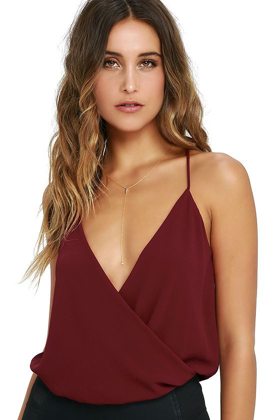 You'll always be at the top of the best dressed list when you've got chic pieces like the Well Dressed Wine Red Bodysuit! Semi-sheer woven poly drapes into a plunging surplice bodice supported by skinny straps and a racerback. Elasticized waist introduces stretch knit thong bottoms.