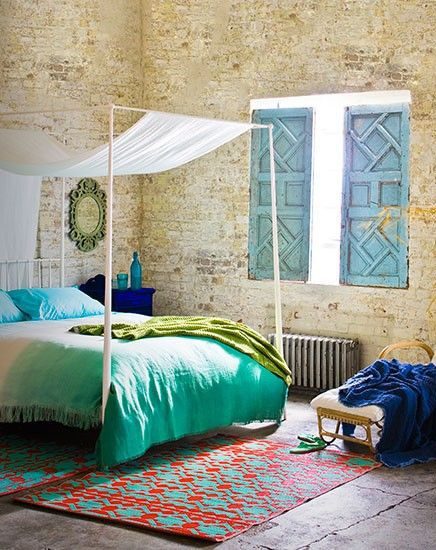 Colorful Moroccan inspired bedroom. Love the hues of blue mixed with white