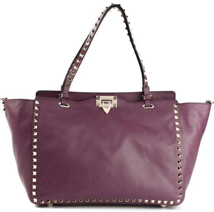 $2,445, Dark Purple Leather Tote Bag: Valentino Garavani Rockstud Trapeze Tote. Sold by farfetch.com.