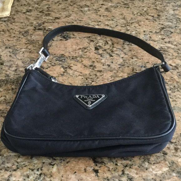 Black Nylon PRADA Clutch , with Strap Small zippered nylon black clutch wristlet. Offers excepted! PRADA Bags Clutches & Wristlets