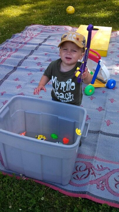 """Magnetic fishing is a great toddler camping toy! Plus great to get a """"little"""" sit down time in a lawn chair fishing beside with them!"""