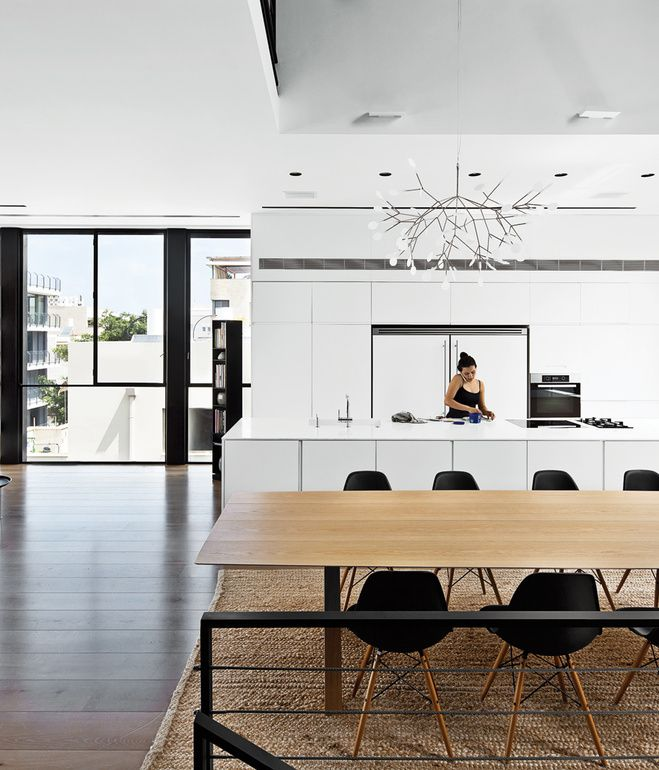 The fourth-floor kitchen features appliances by Miele, and Heracleum II pendants by Bertjan Pot for Moooi hang over both the kitchen isla...