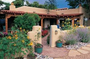 Santa Fe Design Styles Fences | well-designed entry might include a winding path of flagstone and ...