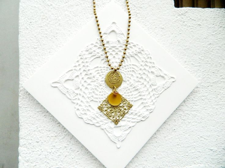 Natanè Planet Rhombus  necklace on a  Mind Madeindesign tile.  #necklace #collane #colors #cream #amethyst #woman #fashion #style #outfit #swarovski #jewel #bijoux #tile #piastrella #bianco #mustard #senape #girl #natanè