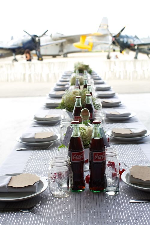 1940's themed wedding. Coke bottle centerpiece. With WWII aircraft.