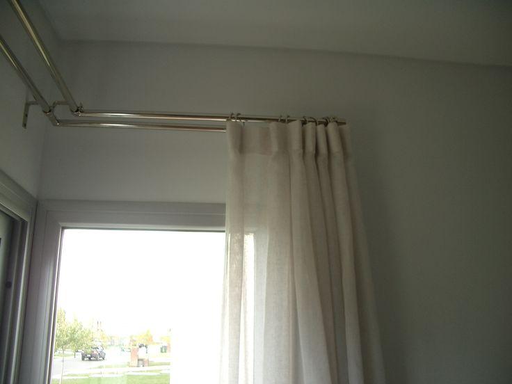 cortina de gasa de lino y cortina de blackout por detras. romina guerrero