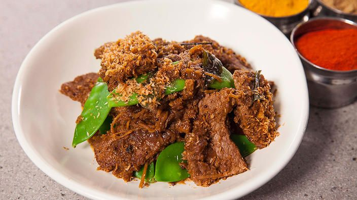 Stir-fried coconut beef. Sweet from the coconut and spicy from the chillies. Add some green vegetables like snow peas. Recipe by Anjum Anand.