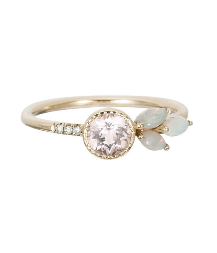 This special piece will make you feel like you stepped straight out of a fairy tale! An absolutely stunning 5mm morganite stone is surrounded by three 1mm diamonds on one side, and three 3x2mm austral