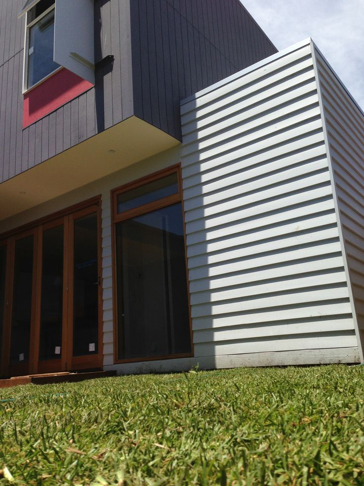 House by Architected. Traditional weatherboard below, plywood above. Tas Oak double glazed windows with Low-E coating.