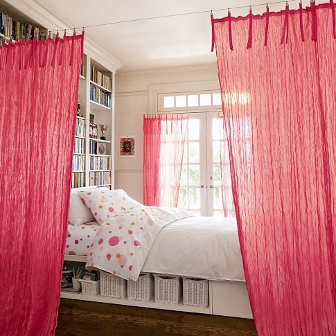 Bed curtains strung up with cable system from PB Teen -- would also be interesting to hang art along a wall