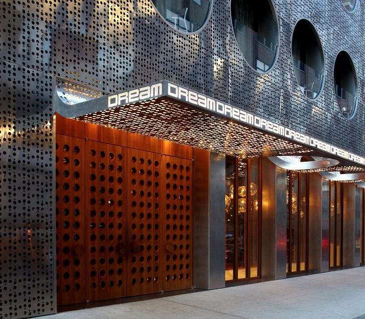 Facade Peels Up At The Ground Level To Form Hotel Canopy And Reveal