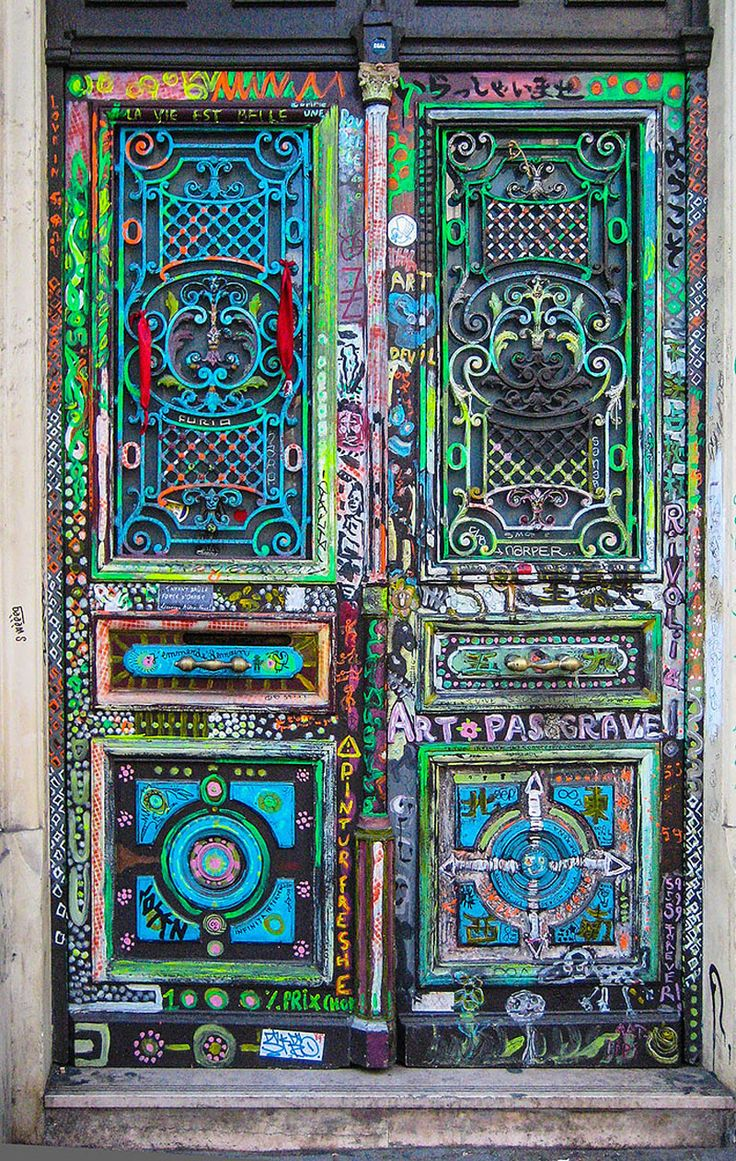 Montmartre, Paris, France ~This seems like an elaborate display of colorful designs and patterns, but there are also words that give this door even more symbolic meaning.