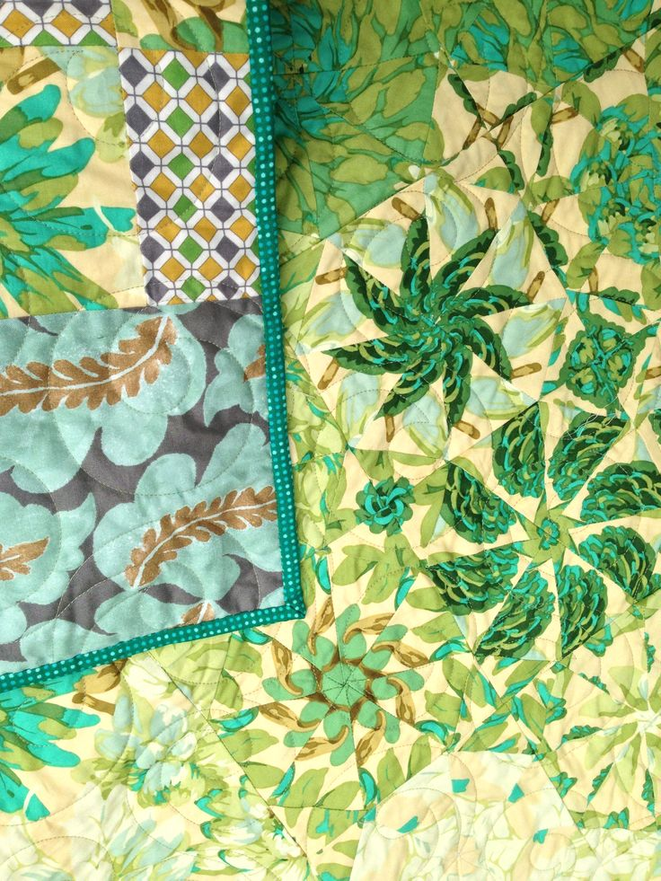 Two sided quilt with One Block Wonder on one side and Leafy Rosy on the other.