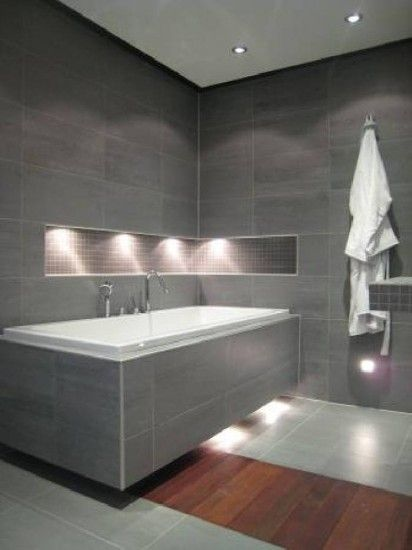 A modern bathroom with grey tiles