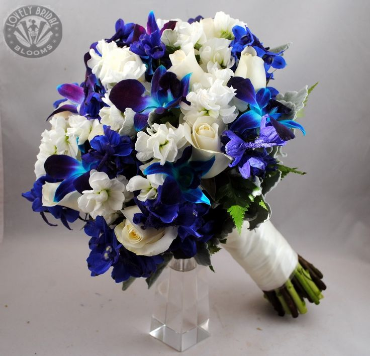 blue orchids blue delphiniums with white stock and white roses breathtaking blue wedding. Black Bedroom Furniture Sets. Home Design Ideas