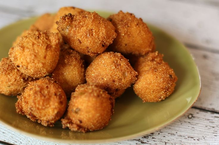 Hush puppies are deep-fried little balls of dough made with cornmeal. Hush puppies are traditionally served with catfish. This is a classic recipe.